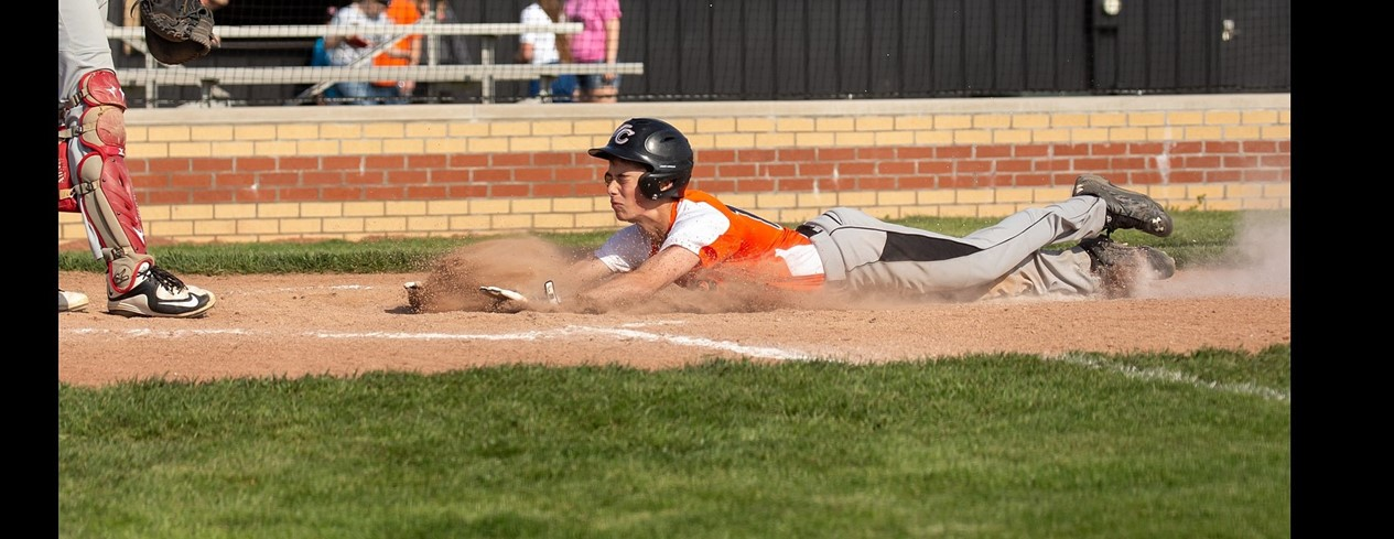 Baseball sliding into base