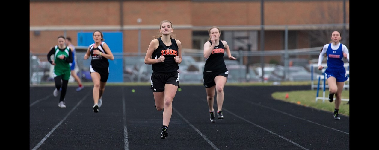 Girls track sprinting for the finish