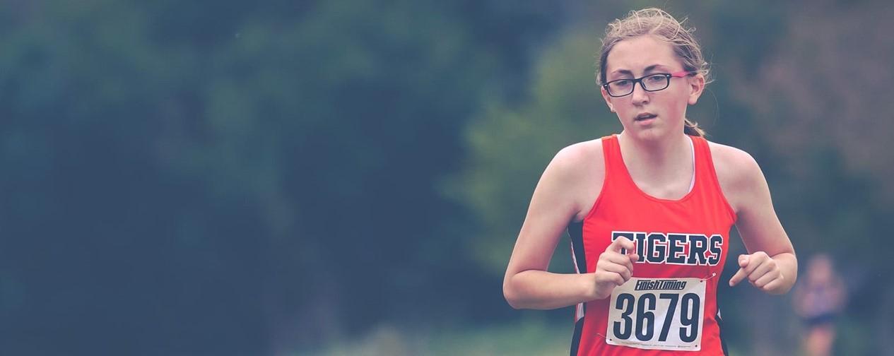Girl running cross country