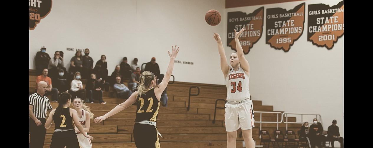 High school girls basketball playe shooting a 3 pointer