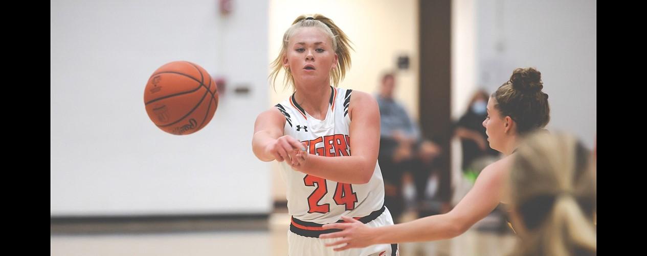 High school girls basketball player making a pass