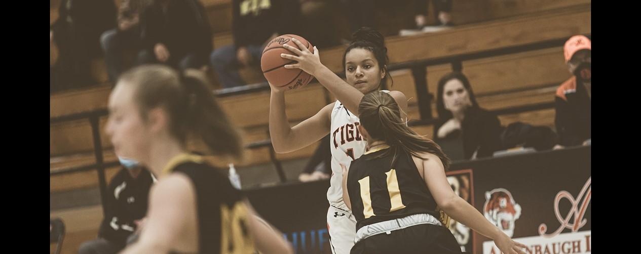 High school girls basketball player passing the ball