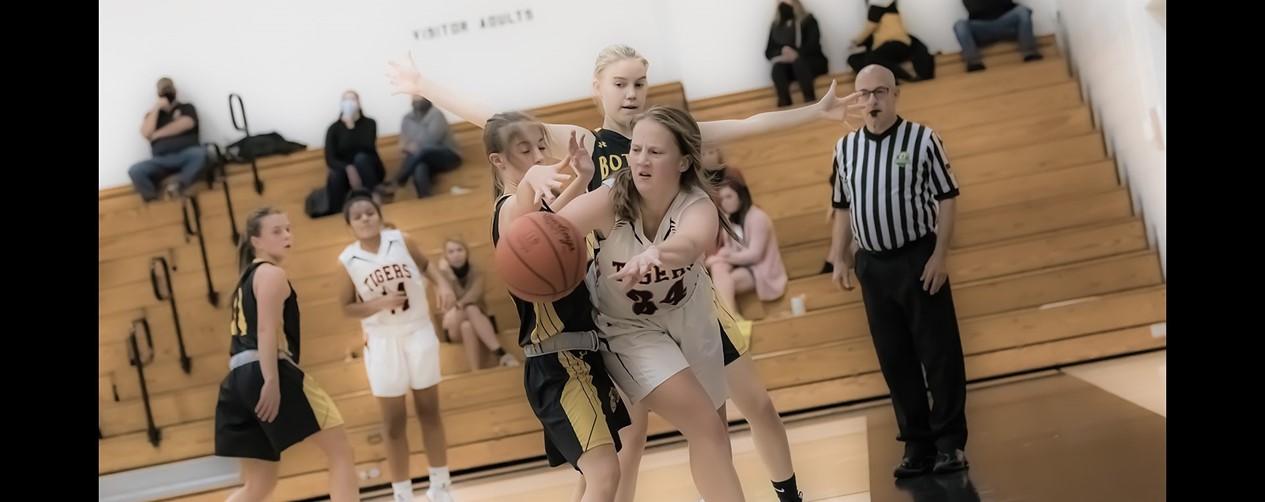High school girls basketball player catching a pass