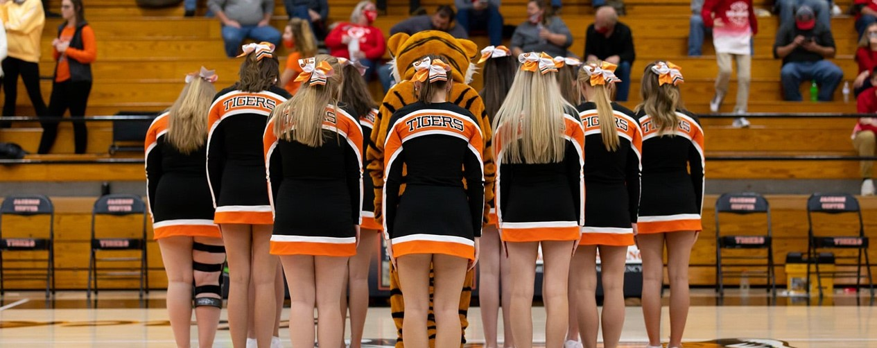 Cheer team with tiger mascot
