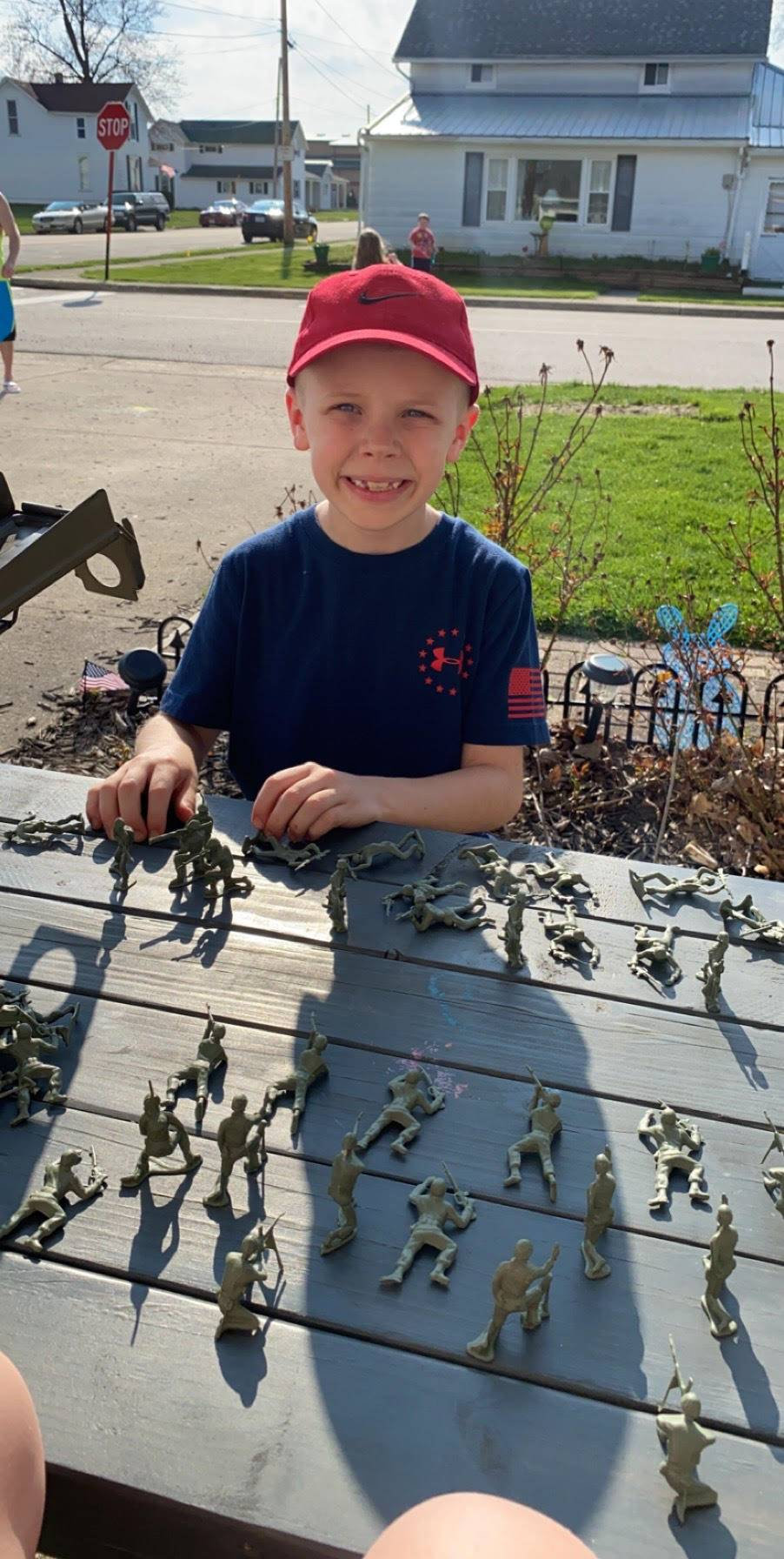 boy with army toys