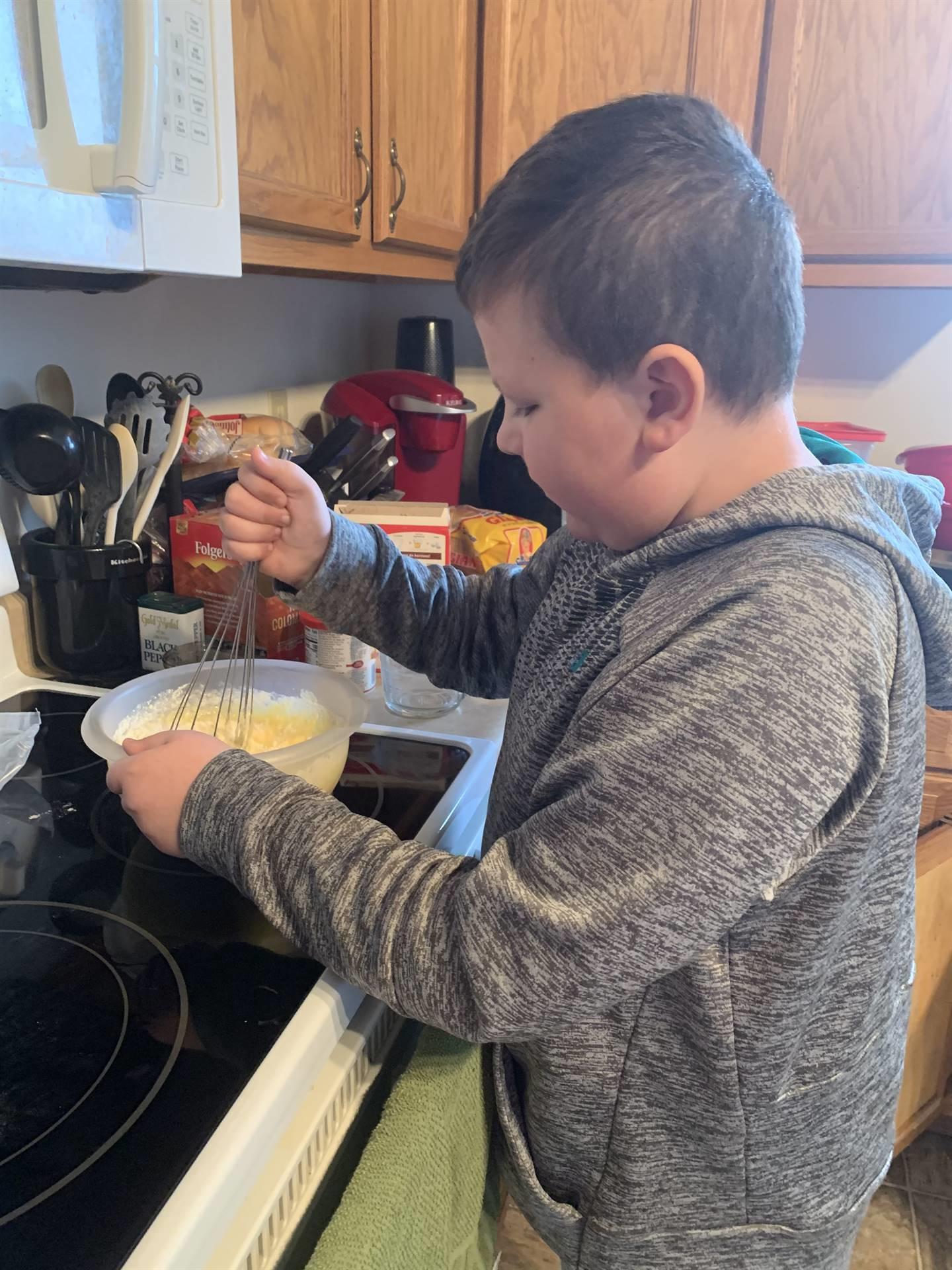 boy mixing cake mix