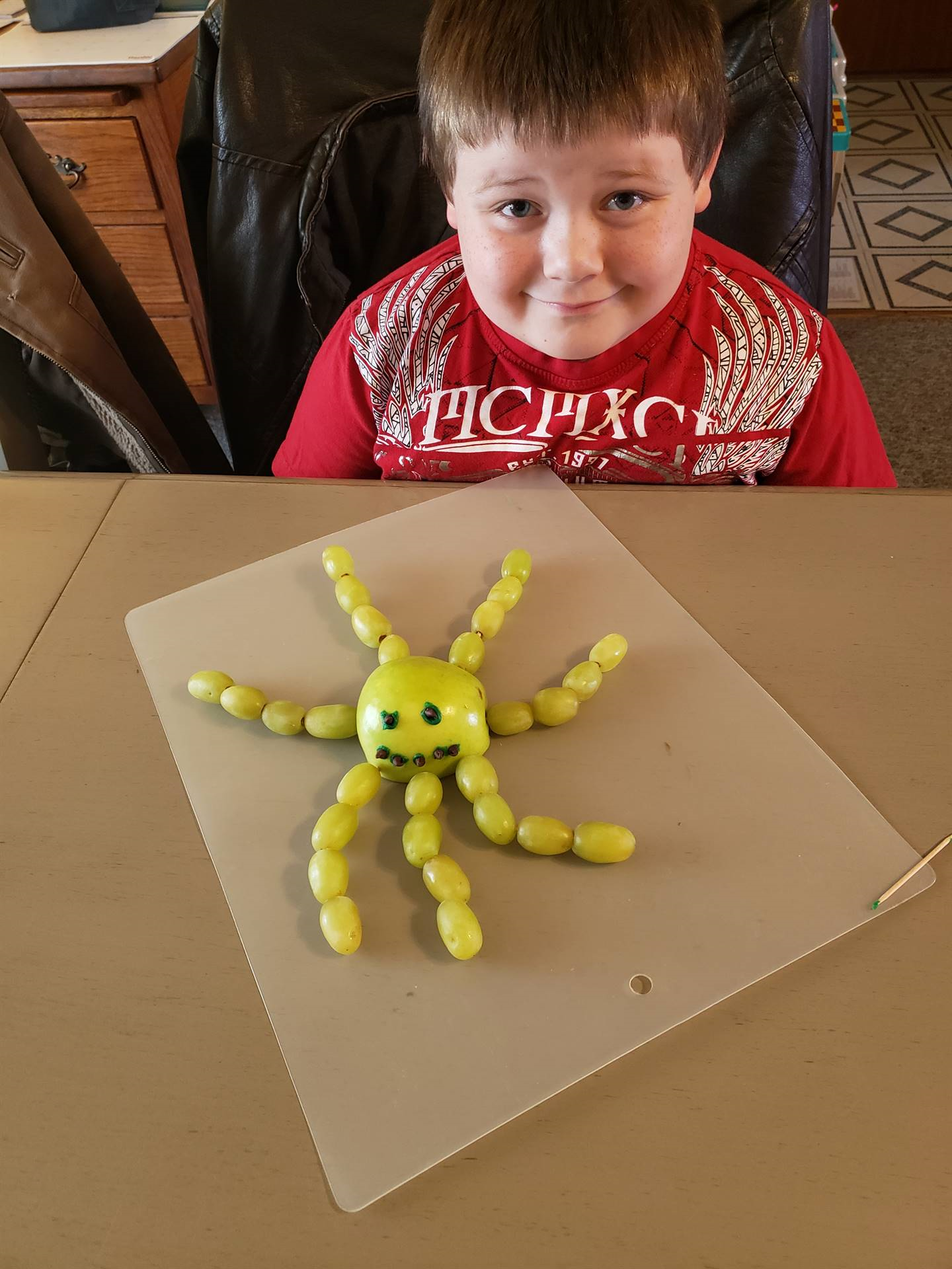boy with fruit octopus