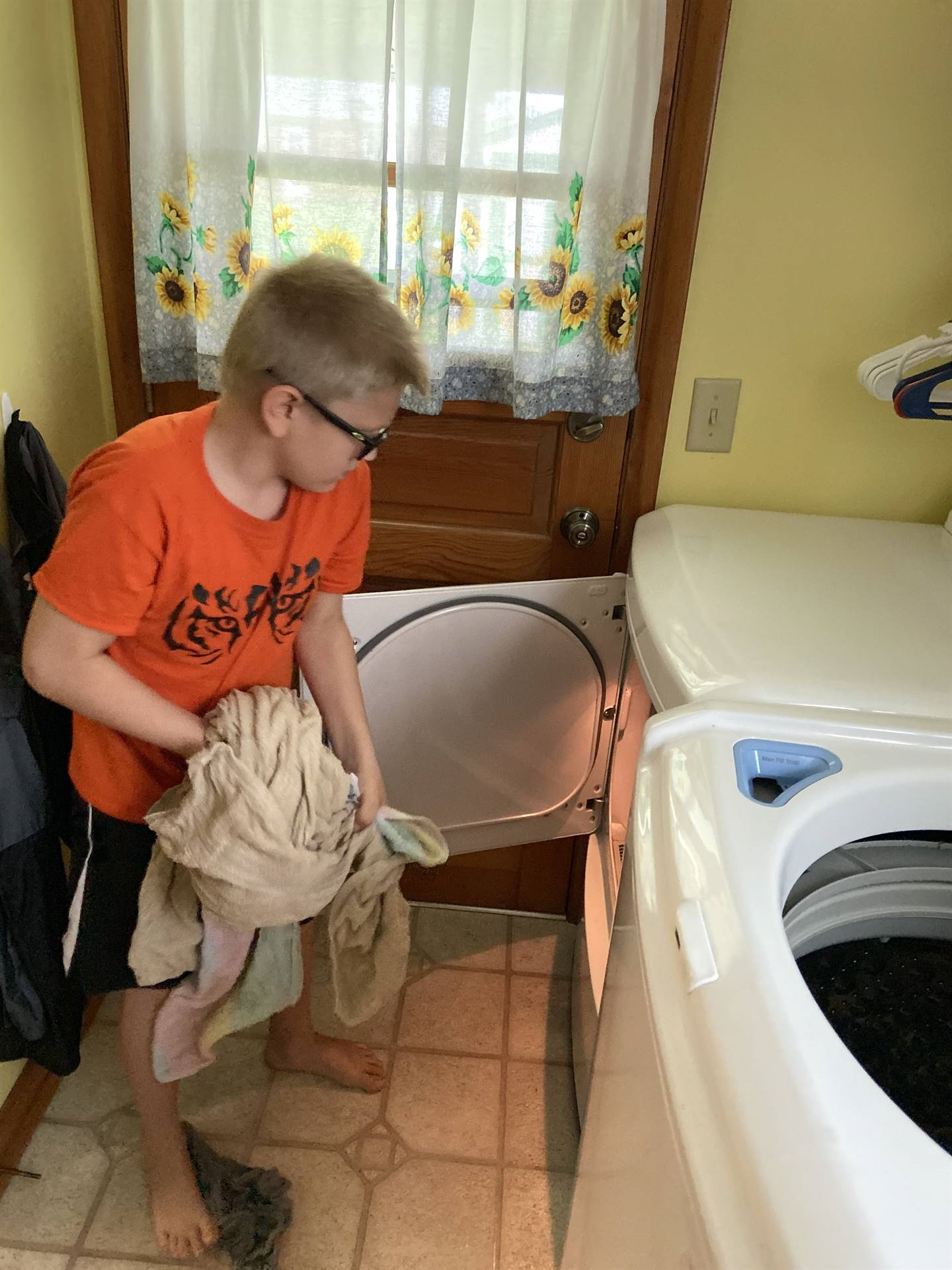 boy with laundry