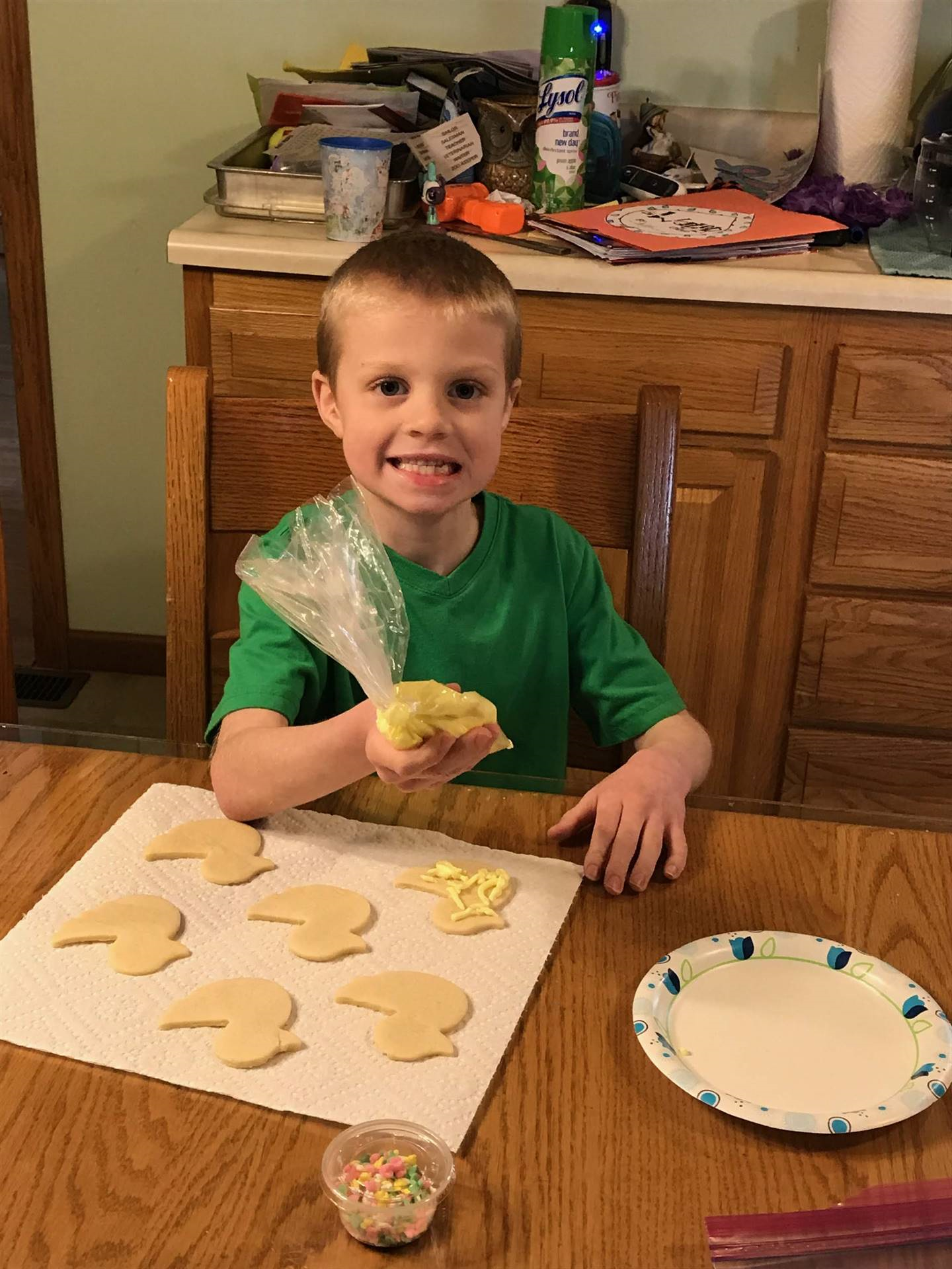 boy decorating cookies