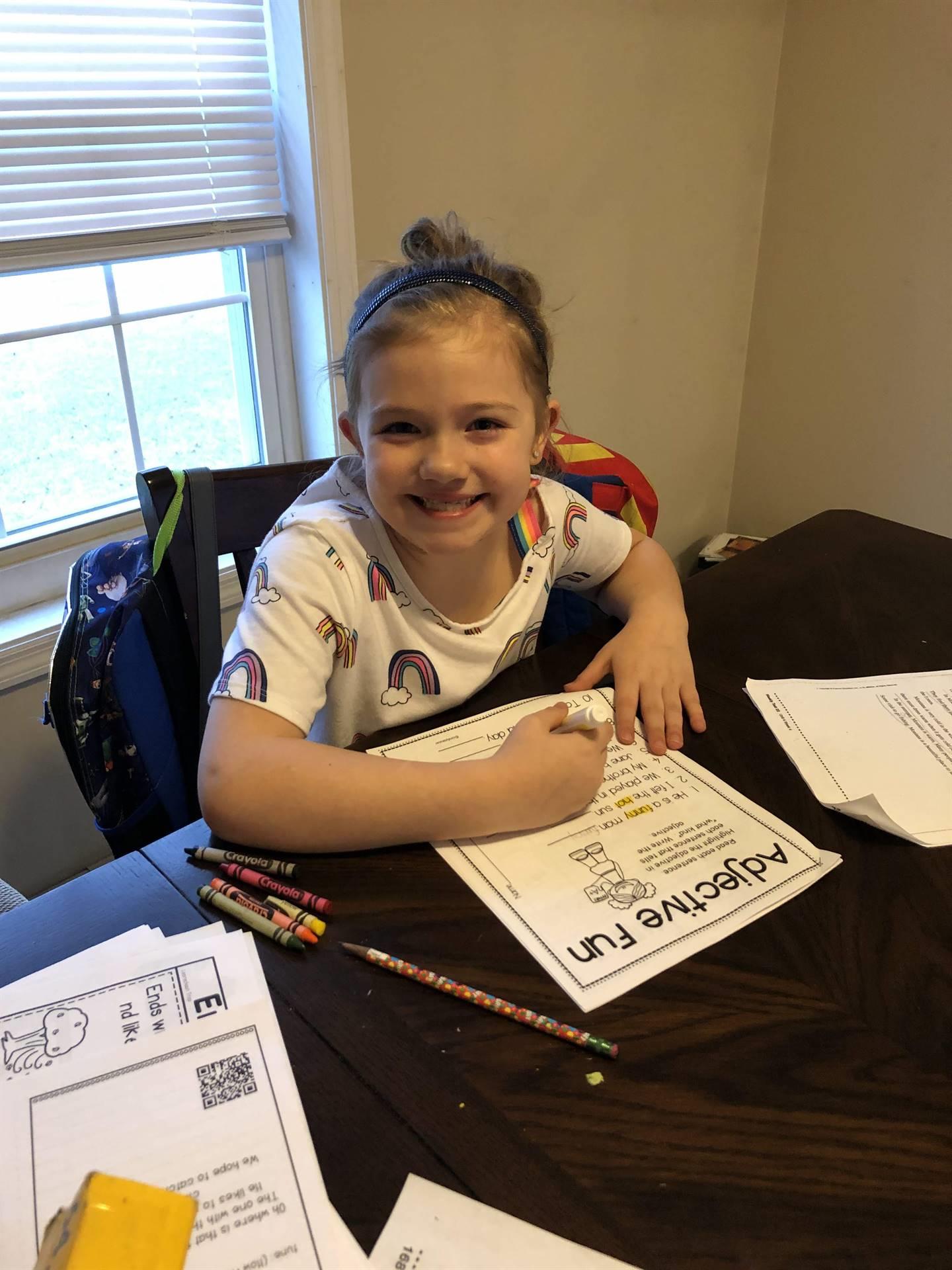 girl working on adjective fun paper