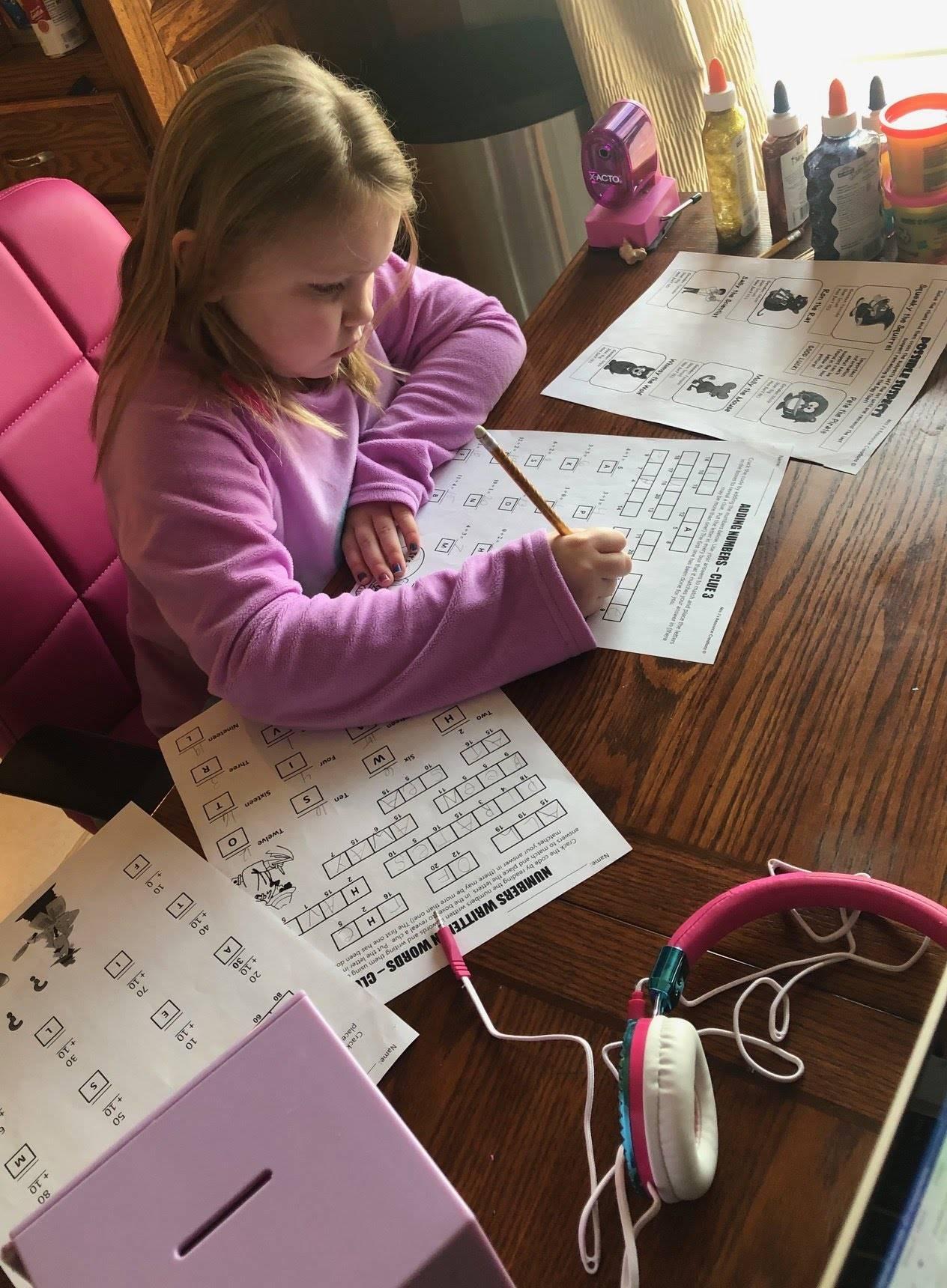 girl working on homework worksheet