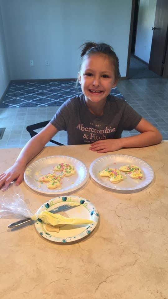 girl decorating cookies