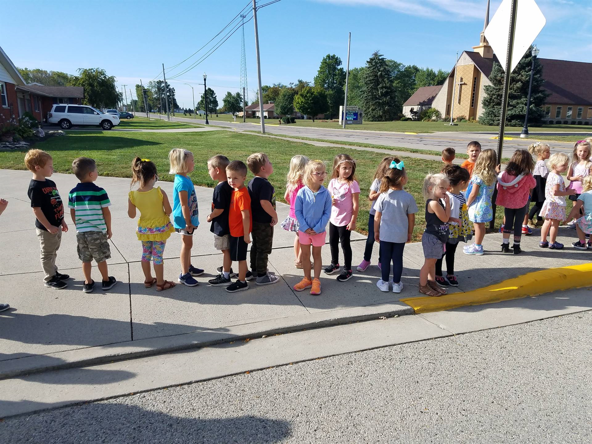 prek students on a walk outside