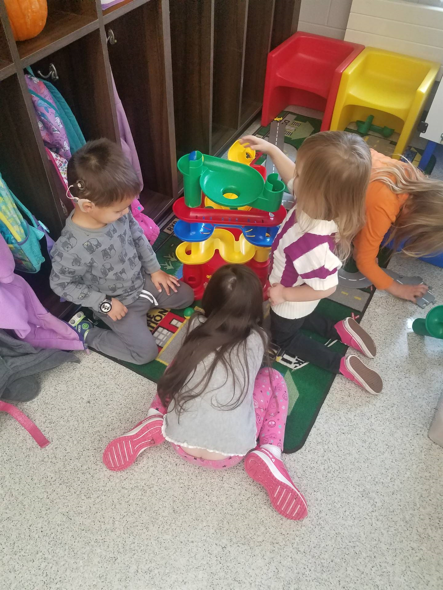 students playing in block center