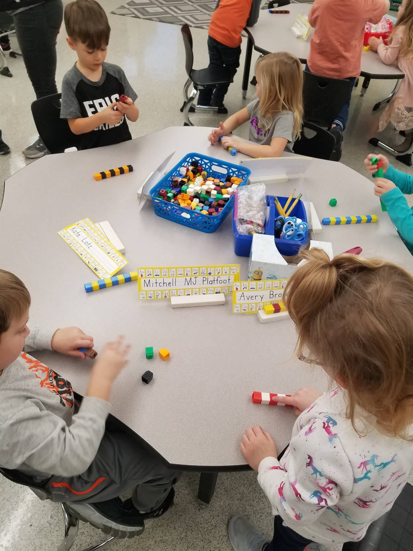 students building with cubes