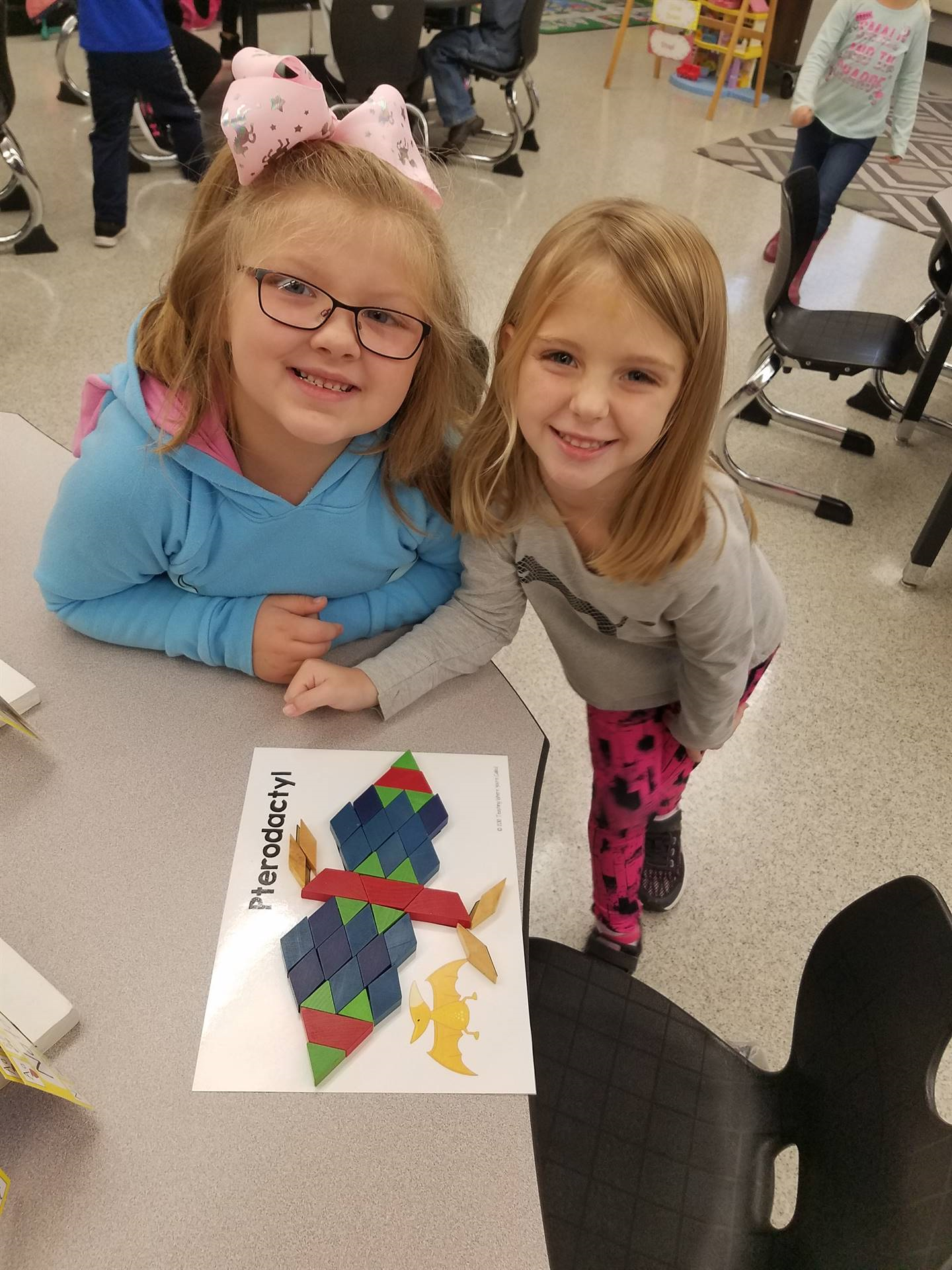 two girls working on puzzles