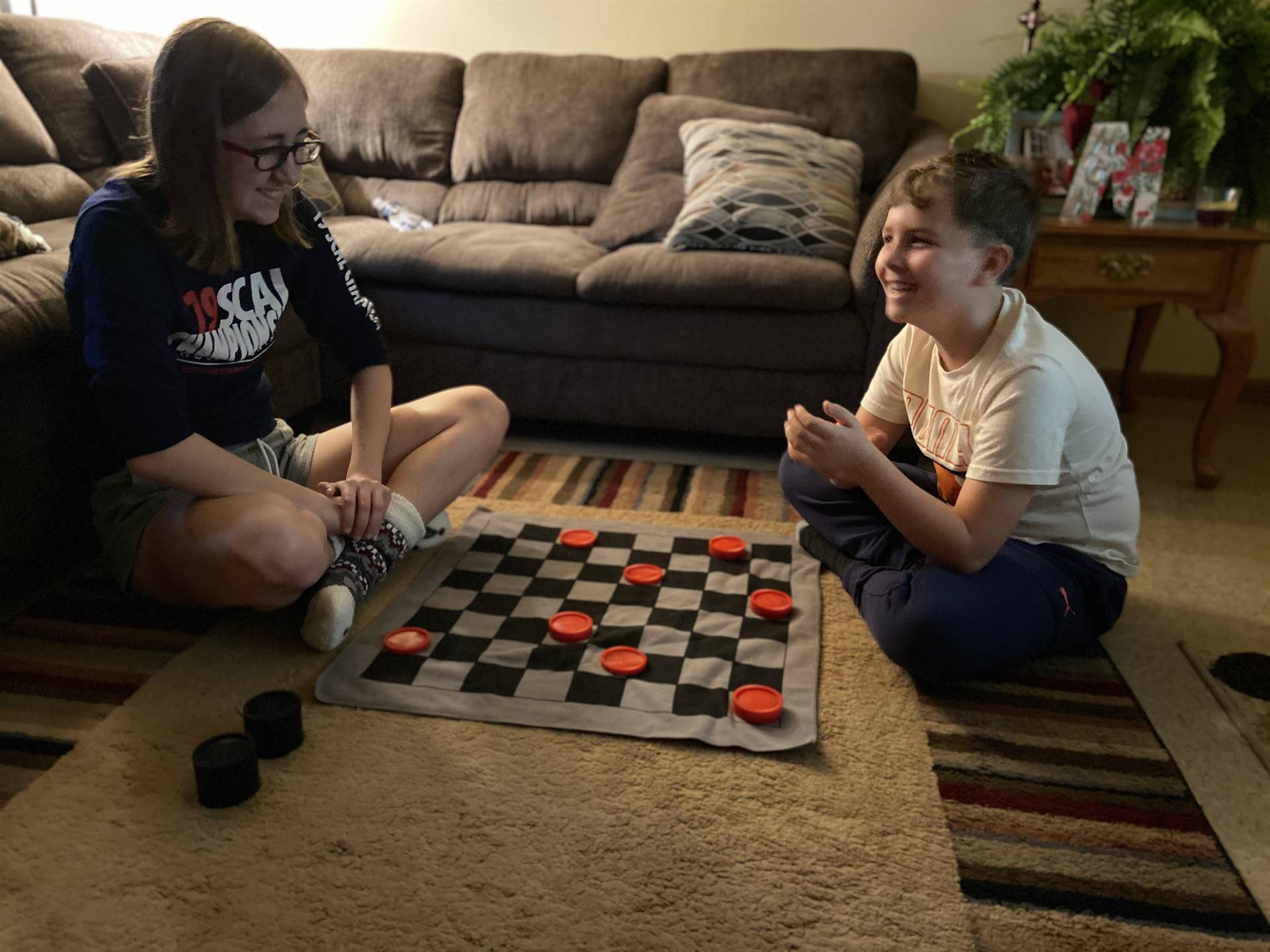 boy playing checkers