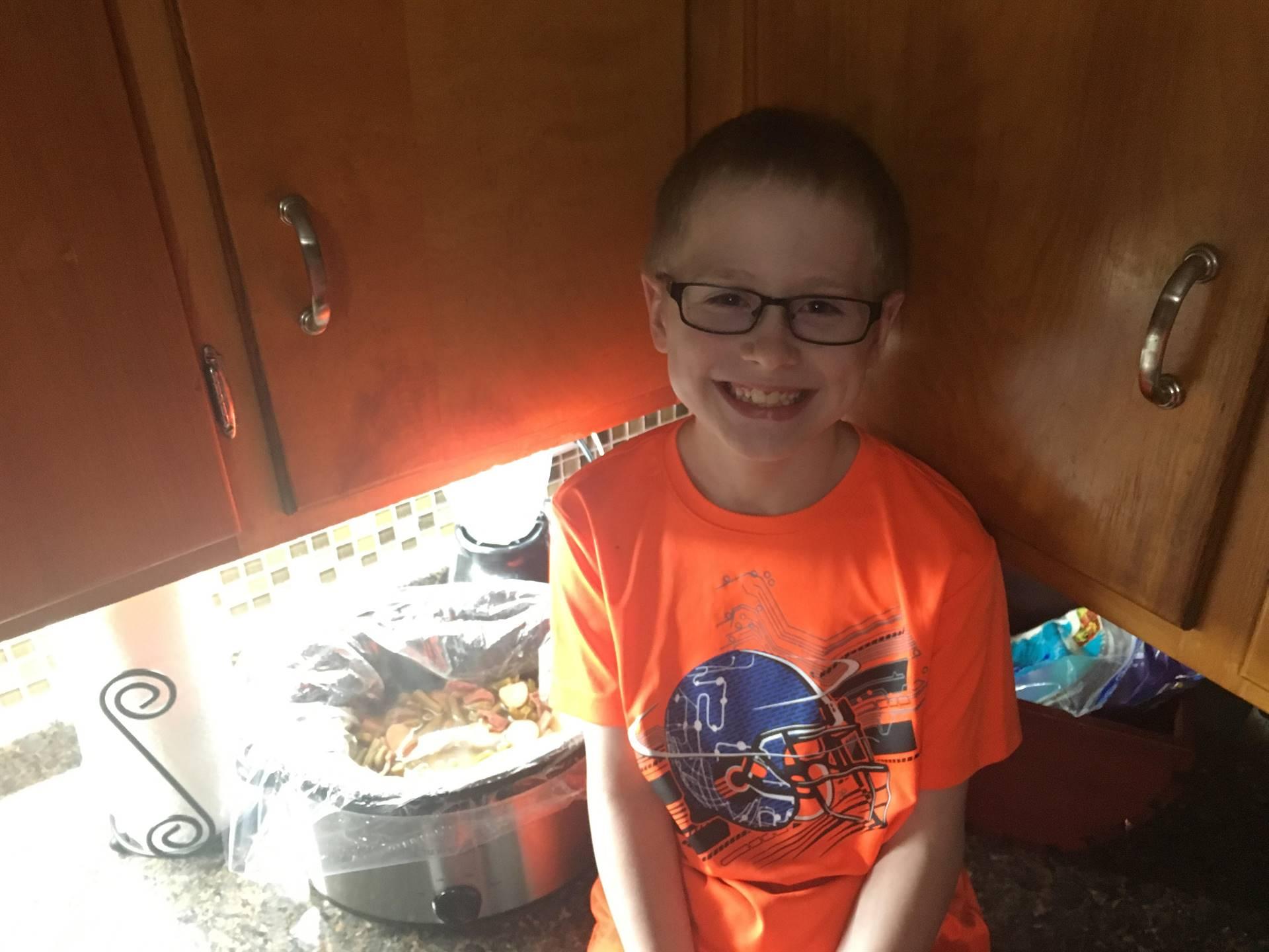 boy with crockpot