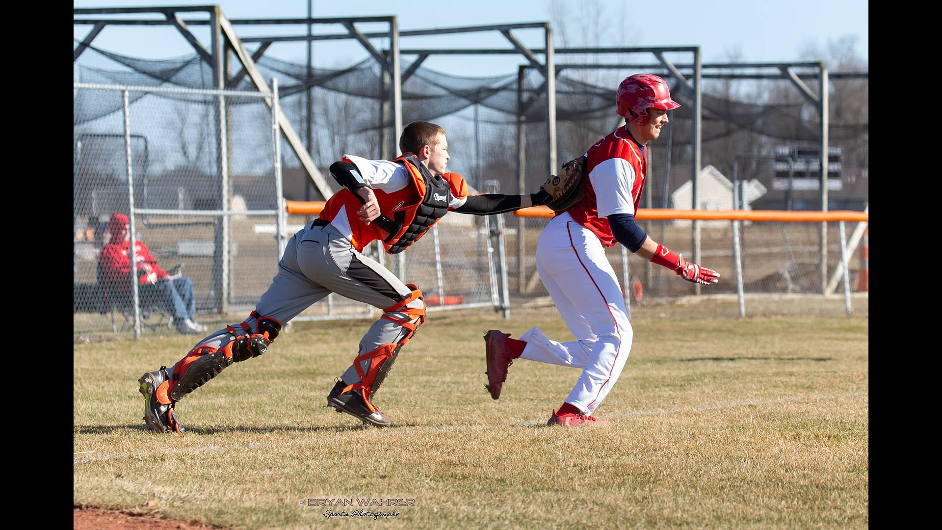 Catcher tagging runner out