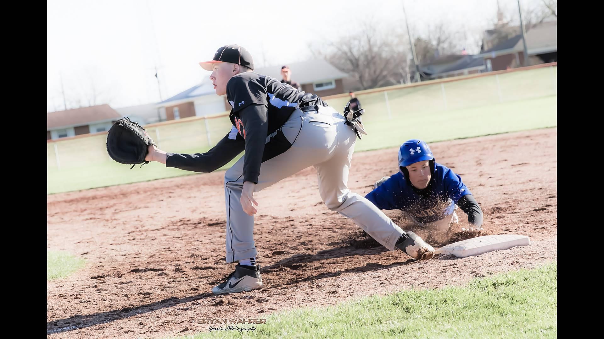 baseball play at the base