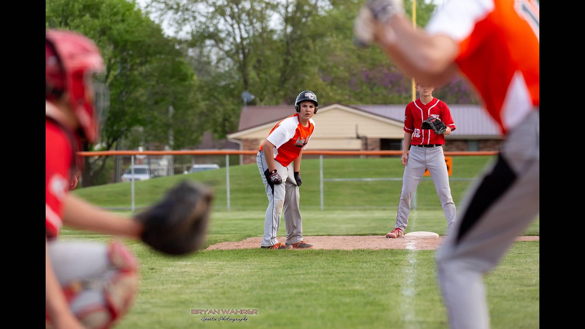 baseball runner at third base and batter-up
