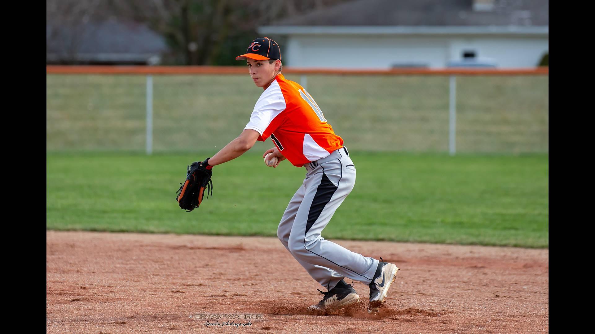 baseball infielder going for the ball
