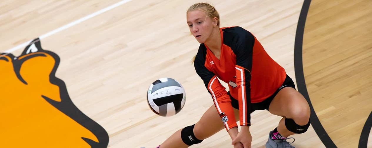 Volleyball player returning ball
