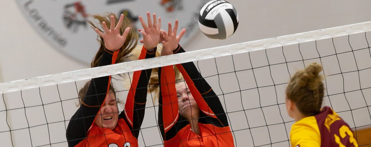 Volleyball girls blocking at the net