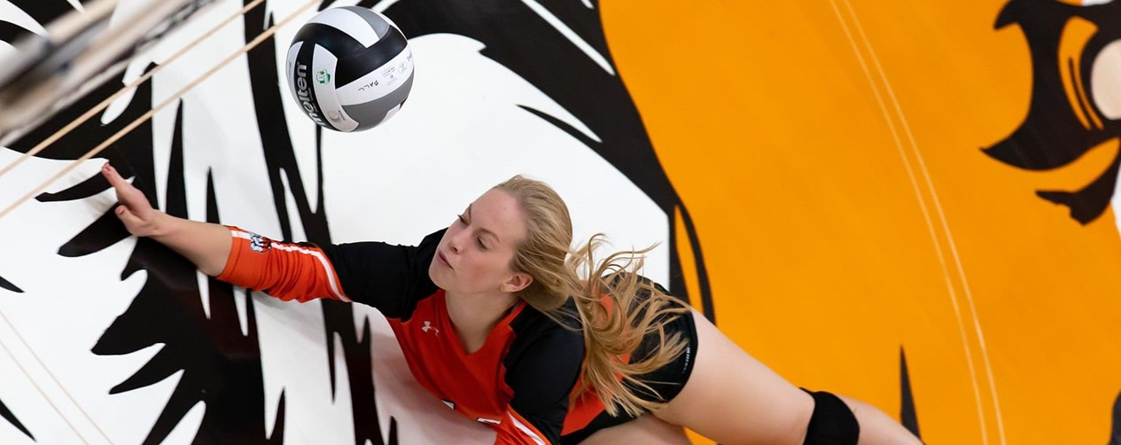 Volleyball player diving for the save