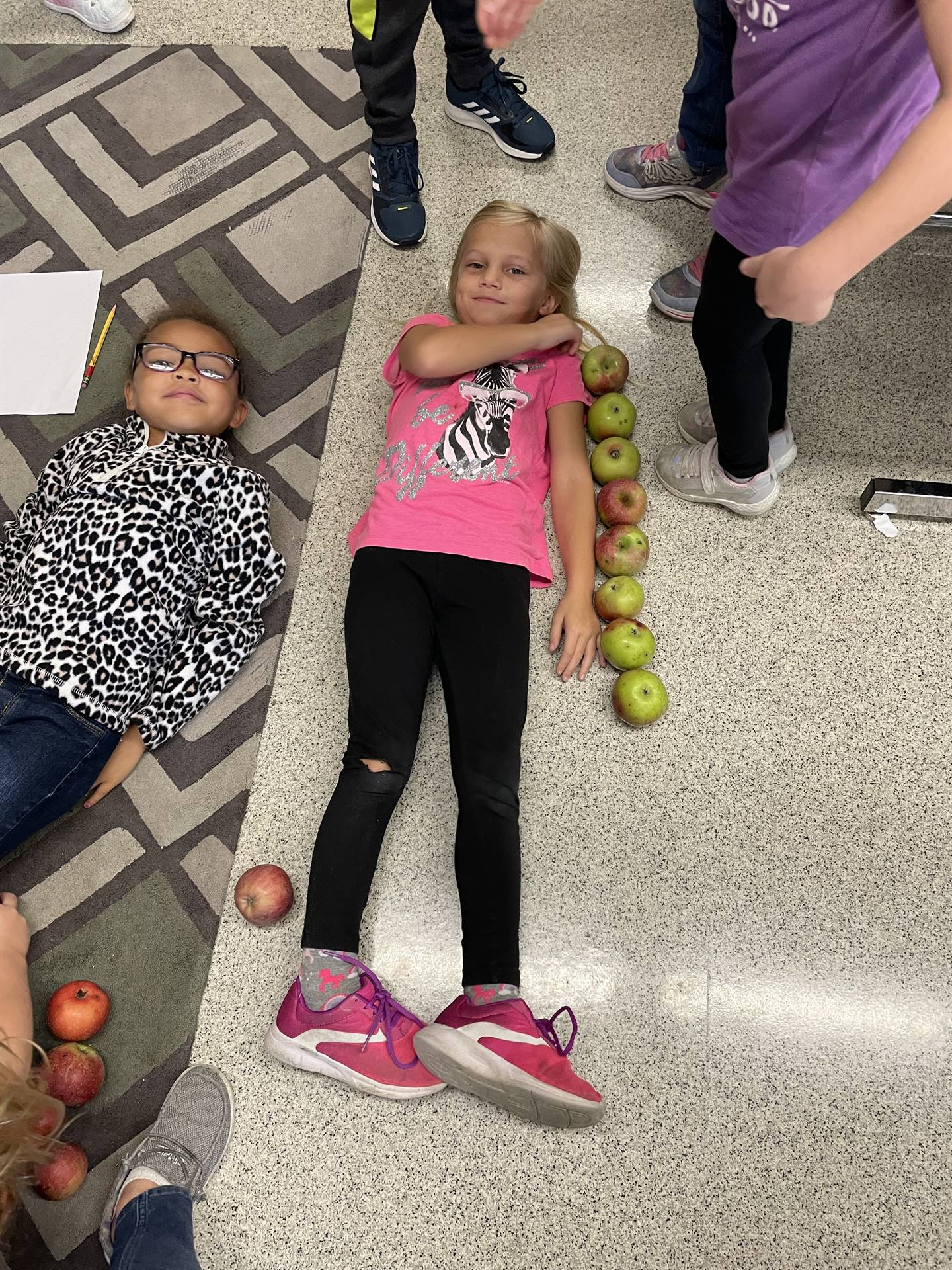 Students with apples for Johnny Appleseed day