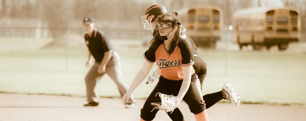 softball girls play at base