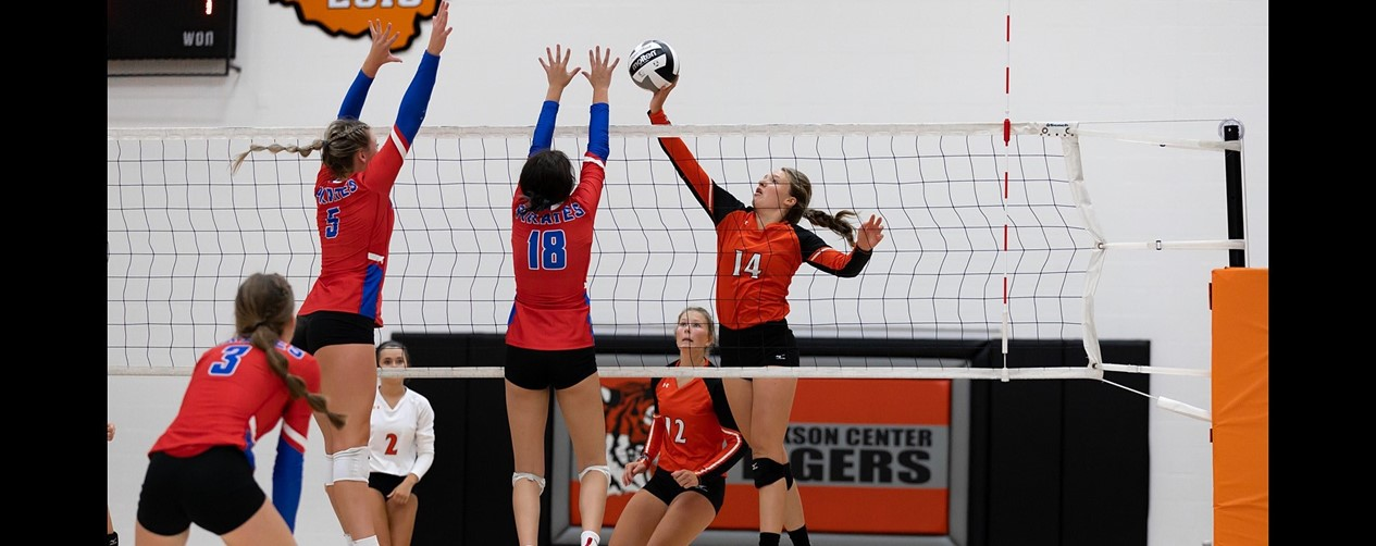 Volleyball blocking at the net