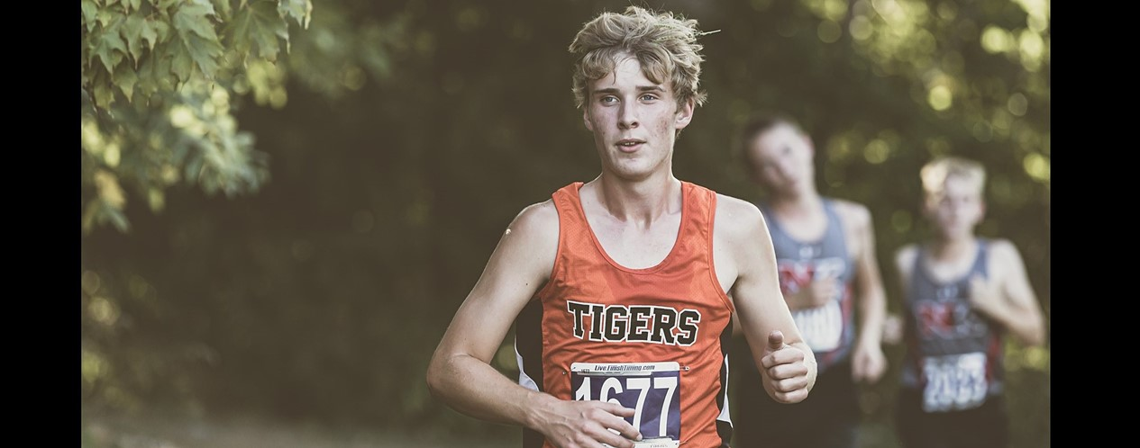 Cross Country Boy Runner
