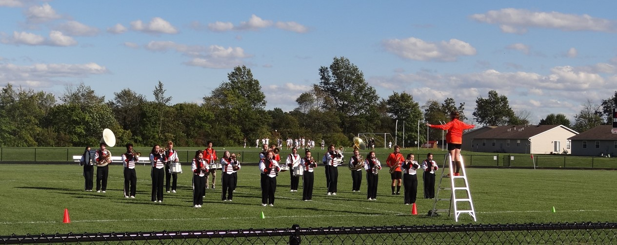 marching band on soccer field for homecoming show